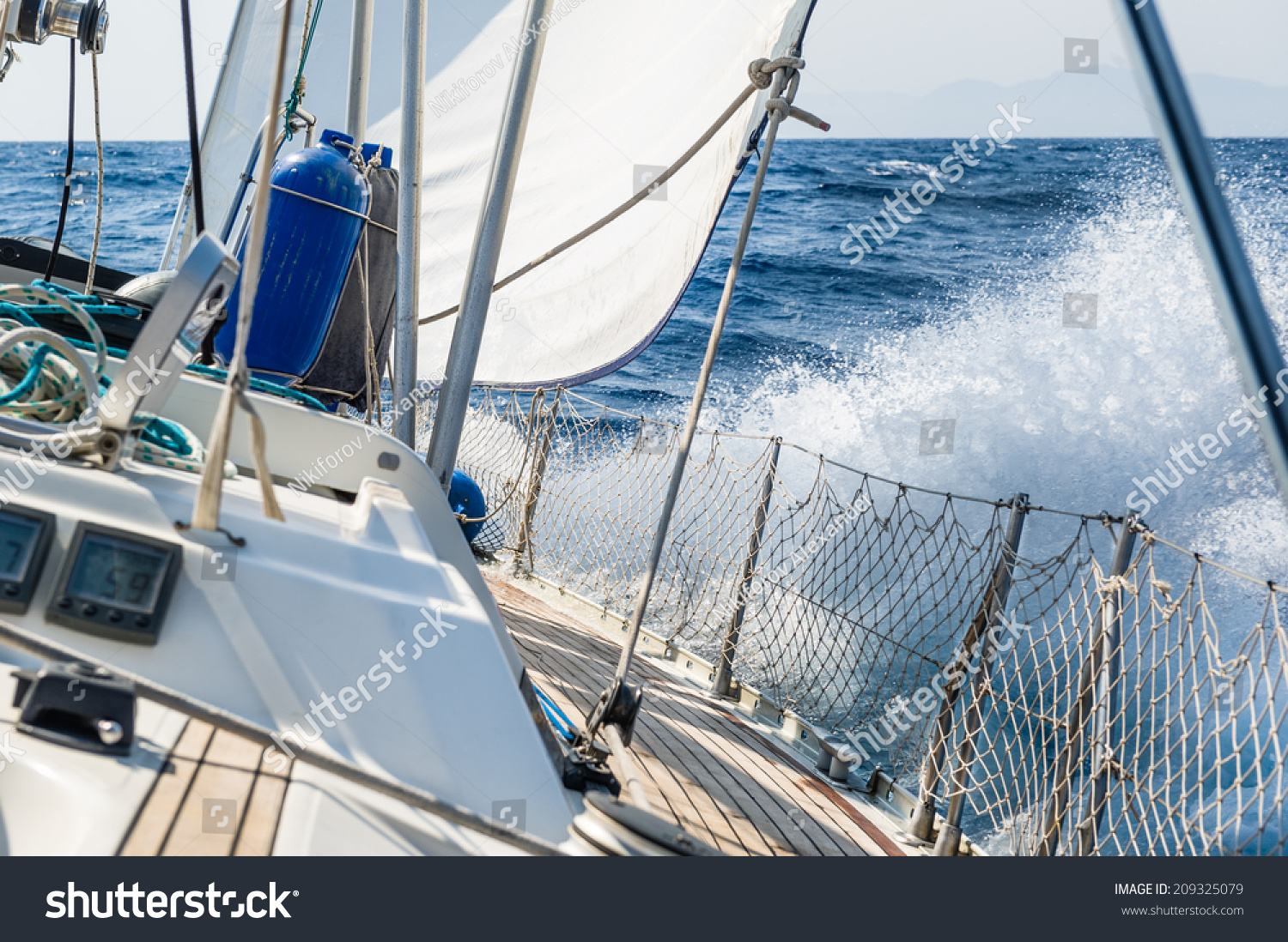 stock-photo-fast-sailing-cruising-yacht-at-heeling-with-splash-209325079