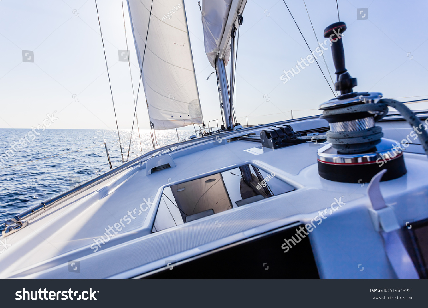 stock-photo-sail-vessel-surfing-on-the-sea-519643951