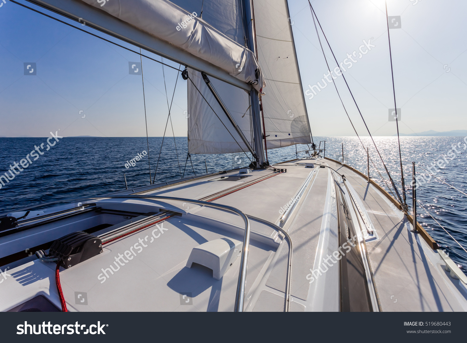 stock-photo-sail-vessel-surfing-on-the-sea-519680443