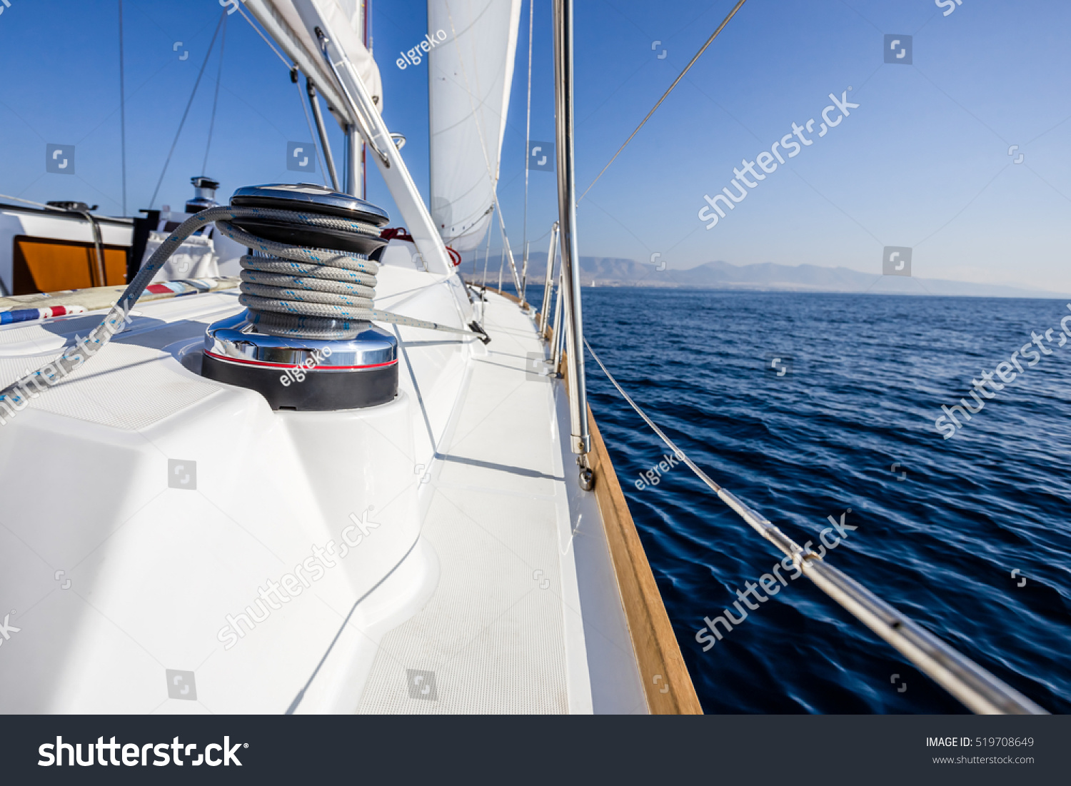 stock-photo-sail-vessel-surfing-on-the-sea-519708649